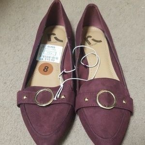 Burgundy suede flats.